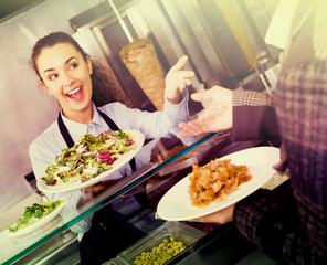 Smiling female worker serving customer