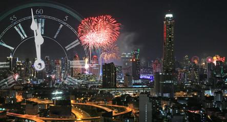 Happy new year 2017, Firework and vintage clock midnight at Bangkok central city, Thailand.