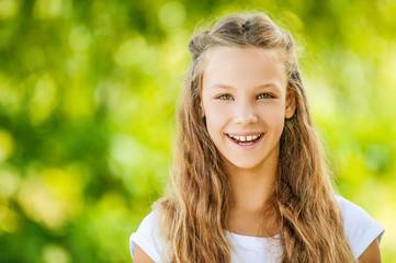 smiling teenage girl in white blouse