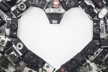 Heart made with cameras on a white background for valentine