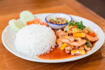 Sweet and sour sauce fried with pork served with rice