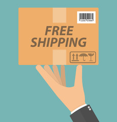 Free shipping concept. Hand holding cardboard package with delivery signs, free shipping text and barcode on it. Flat design