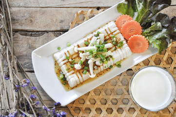 tofu with milk on the wooden table