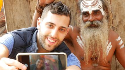 Tourist taking a selfie with Sadhu - Holy Man, in Varanasi, India