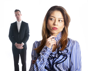 female subordinate worries anxiously while male boss stands in b