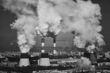Industrial Smoking chimneys. The destruction of the ozone layer