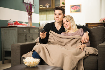 Couple getting all cozy and watching TV
