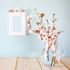 spring white flowers on wooden table