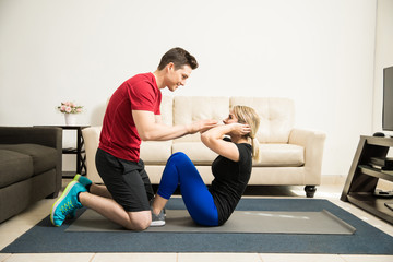 Couple helping each other exercise
