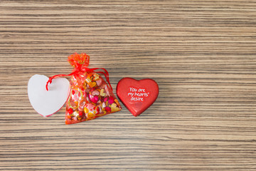 pink and red heart on a wooden background for lovers and valenti