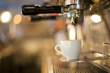 a cup of coffee is coffee machine