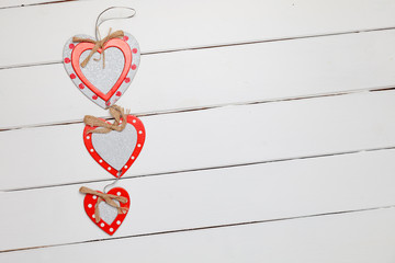 Hearts on rustic wooden background