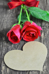 Blank greeting card with heart shape and red rose flowers
