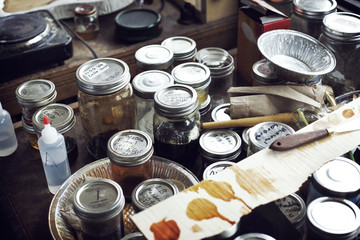 High angle view of jars and containers on workbench in workshop