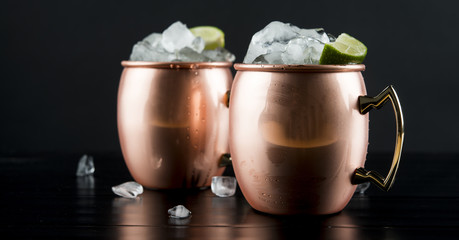 Close up of moscow mules on table against black background