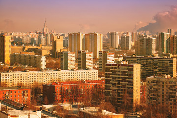 View on a modern city. Tall apartment buildings. Sunset, retro treatment