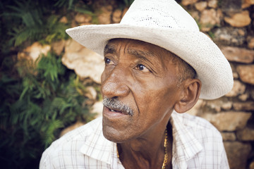Close up of mature man wearing hat