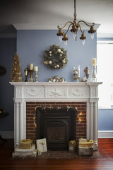 Fireplace with Christmas decoration and gift boxes at home