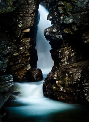 Waterfall in a rocky crevice.