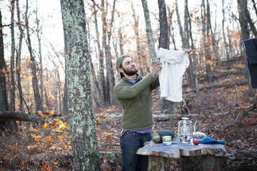 Man drying clothing on clothesline