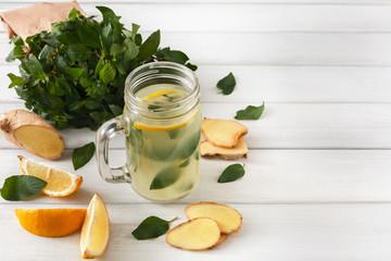 Natural detox lemonade smoothie ingredients on white wood background