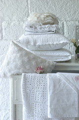 white brick wall concept with pillows and linen