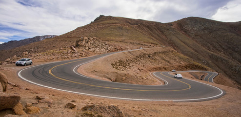 Cars on the steep, winding road up Pikes Peak, Colorado