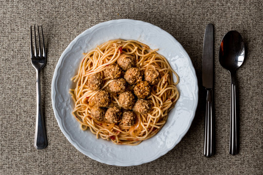Meatballs with spaghetti bolognese in white plate.