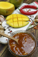 Bowl of homemade Mango Chutney on old wooden table