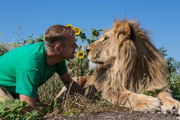 The man kissing the lion in safari park Taigan, Crimea, Russia