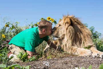 The man kissing the lion in safari park Taigan, Crimea, Russia