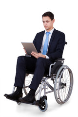 Handicapped Businessman Using Digital Tablet