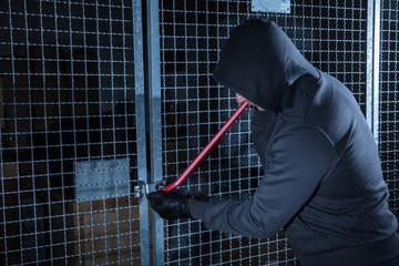 Burglar Trying To Break The Gate