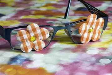 Closeup of girl child glasses with funky flowers on the eye lens