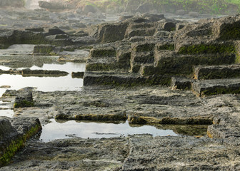oceanfront landscape in the form of steps. Similar to the old ruins. Bali