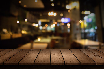 Blur coffee shop or cafe restaurant with abstract bokeh light