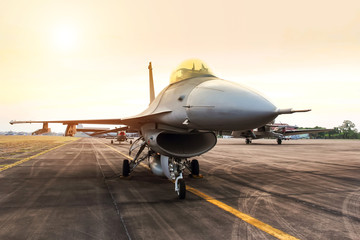 falcon fighter jet military aircraft parked in the base airforce on sunset