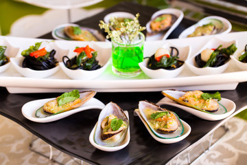 Steamed sea mussels. Large blue mussels on  plate