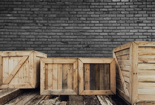 Old wooden box on brick background