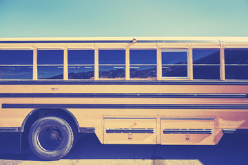 Retro stylized close up picture of a school bus side.