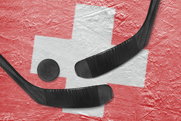 Swiss flag and two hockey sticks hockey