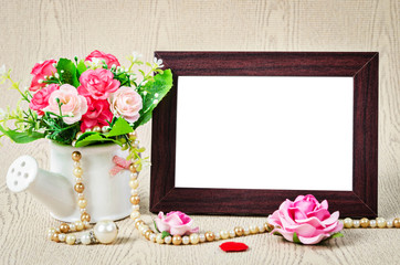 Empty old wooden photho frame with roses.