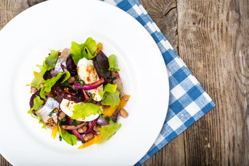 Salad with herring, beetroot, paprika, red onion, mustard and ba