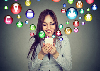 Woman using smartphone application icons flying out of screen