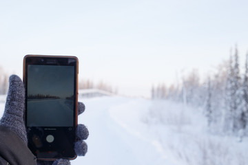 cell phone in gloved in nature