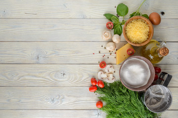 ingredients for pizza on a wooden background top view