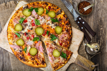 Homemade pizza with ham and mushrooms