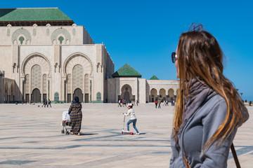 Tourist outside Hassan II Mosque in Casablanca, Morocco.