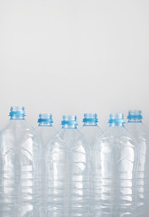 clean empty plastic water bottles on table - recycling and food