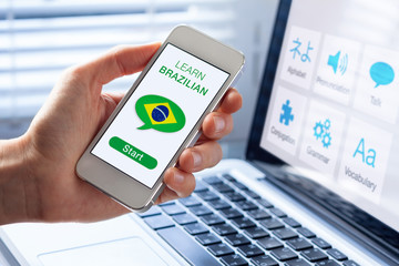 Learn Brazilian Portuguese online concept, mobile phone, flag of Brazil